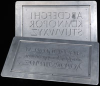 Two engraved metal printing plates. Calligraphy by Hermann Zapf. Click to enlarge.