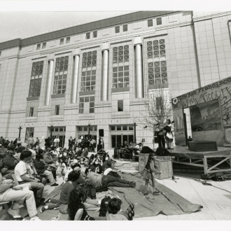 People watching S.F. Mime Troupe outside Main Library, 1996